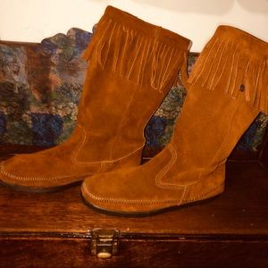 Minnetonka mid calf moccasins with fringe roll top
